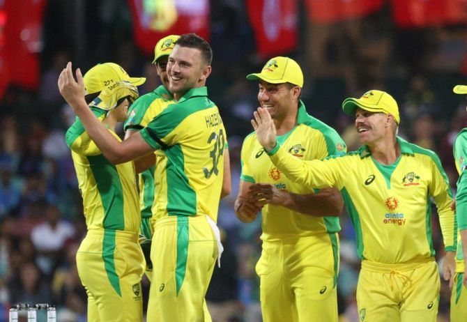 Australia's Josh Hazlewood and Alex Carey celebrate with Marcus Stoinis and David Warner after taking the wicket of India's Shreyas Iyer