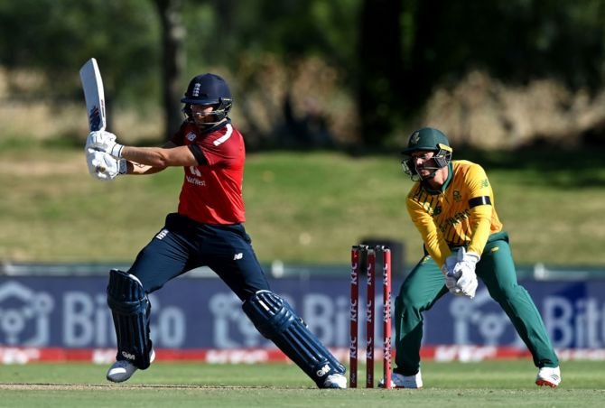 England's Dawid Malan  plays a shot as South Africa's wicketkeeper Quinton de Kock looks on during the second T20 International at Boland Park in Paarl, South Africa, on Sunday.