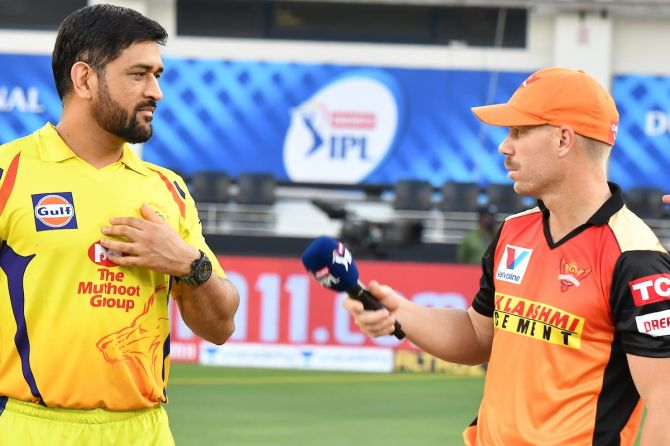 Chennai Super Kings captain Mahendra Dingh Dhoni and Sunrisers Hyderabad captain David Warner chat ahead of their IPL match at the  Dubai International Cricket Stadium, on Friday.
