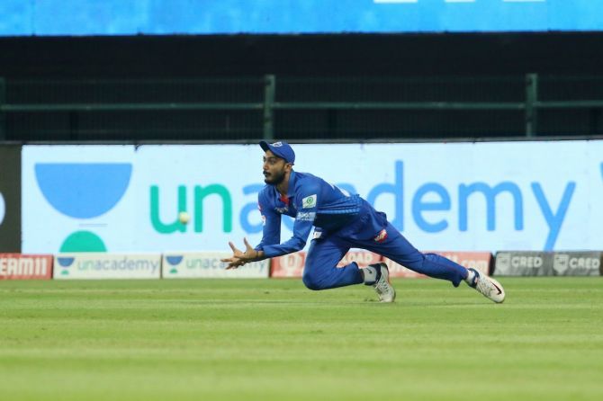 Axar Patel takes the catch to dismiss Ishan Kishan.