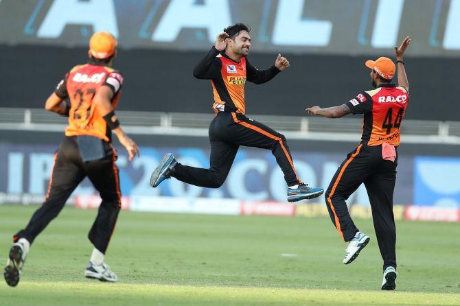 Rashid Khan celebrates the wicket of Sanju Samson.