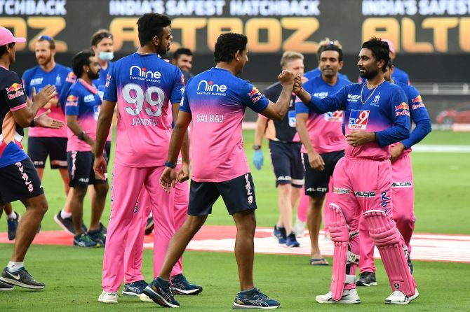 Rahul Tewatia is congratulated by his Rajasthan Royals teammates after steering the side to a thrilling victory over SunRisers Hyderabad in the IPL match in Dubai on Sunday.