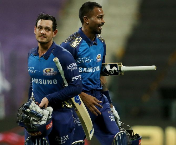 Quinton de Kock and Hardik Pandya celebrate an easy victory