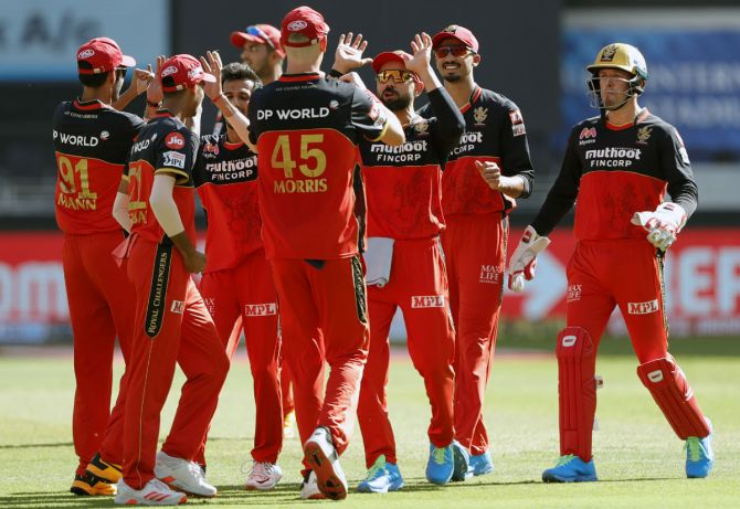 Royal Challengers Bangalore's players celebrate after Yuzvendra Chahal gets the wicket of Sanju Samson