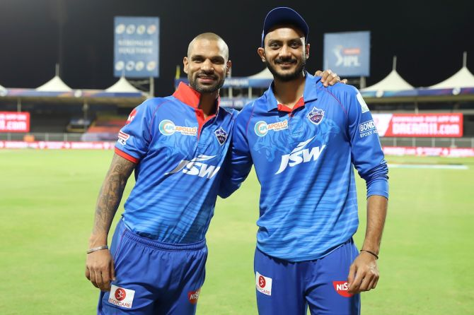 Delhi Capitals heroes Shikhar Dhawan and Axar Patel celebrate victory over Chennai Super Kings in the IPL match in Sharjah on Saturday.