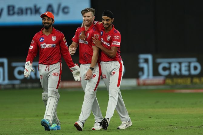 James Neesham is congratulated by Arshdeep Singh and K L Rahul after dismissing Prithvi Shaw.