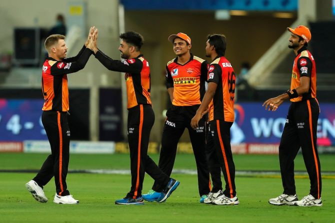 Sunrisers Hyderabad spinner Rashid Khan celebrates with skipper David Warner after taking the wicket of Chris Gayle