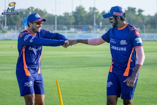 Mumbai Indians' Aaditya Tare and Jasprit Bumrah have some fun during a training session