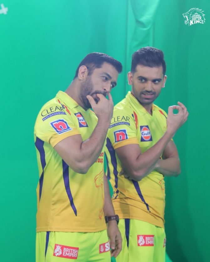 Chennai Super Kings captain Mahendra Singh Dhoni gives bowler Deepak Chahar lessons on how to whistle during a promotional event on Tuesday