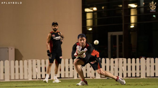 RCB seniors AB de Villiers and Virat Kohli at a team training session