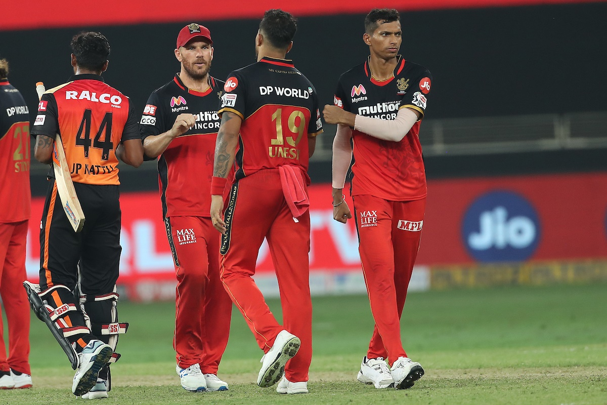 Royal Challengers Bangalore players Aaron Finch, Umesh Yadav and Navdeep Saini celebrate victory over SunRisers Hyderabad in the IPL match in Dubai on Monday.