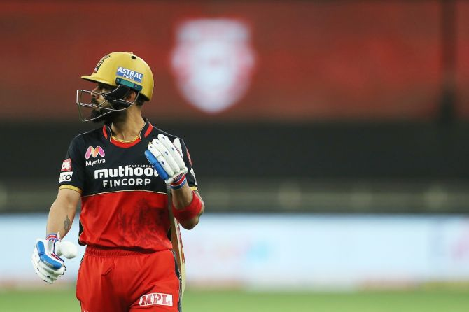 Royal Challengers Bangalore captain Virat Kohli reacts after being dismissed during the IPL match against Kings XI Punjab, at the Dubai International Cricket Stadium