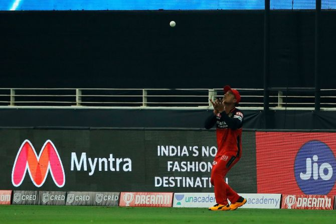 Pawan Negi takes a well-judged catch to dismiss Rohit Sharma.