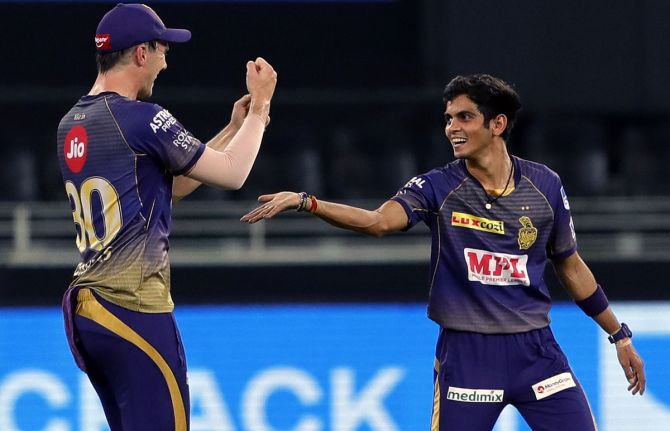 Kamlesh Nagarkoti, right, celebrates with teammate Pat Cummins after taking the wicket of Robin Uthappa