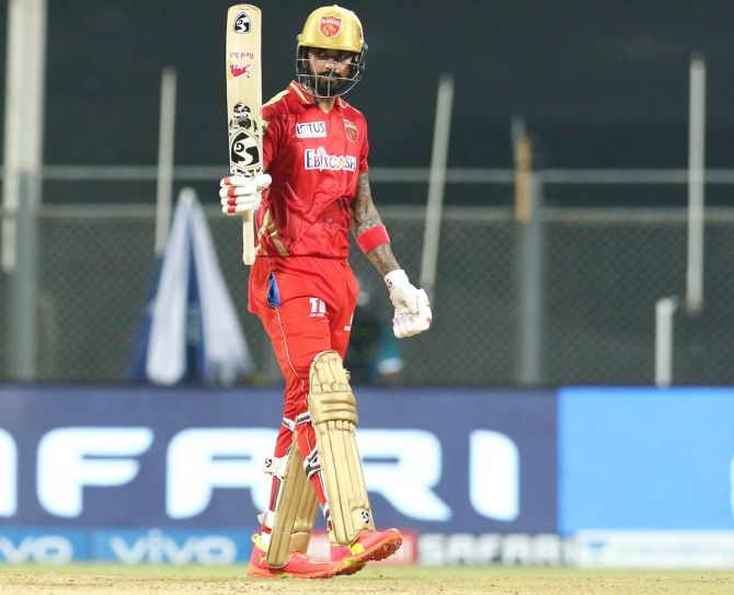 K L Rahul celebrates after completing his 50