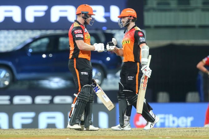 Sunrisers Hyderabad batsmen Jonny Bairstow and Kane Williamson celebrate a boundary during the IPL against Punjab Kings, in Chennai, on Wednesday.