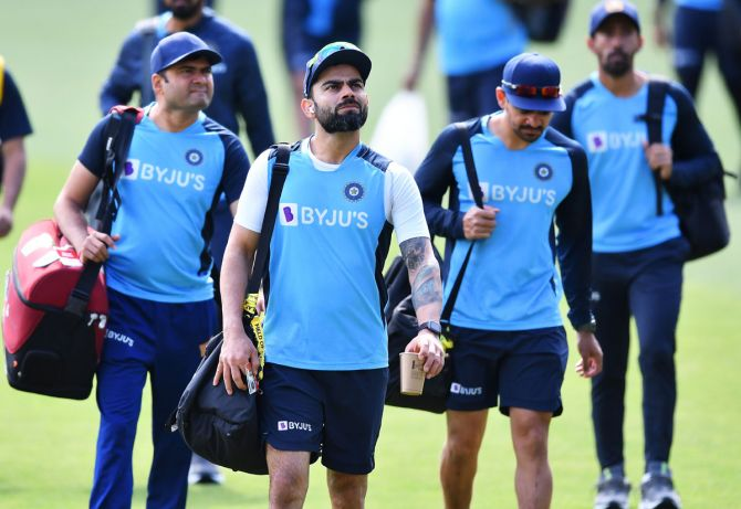 Skipper Virat Kohli and his India teammates get ready for a training session
