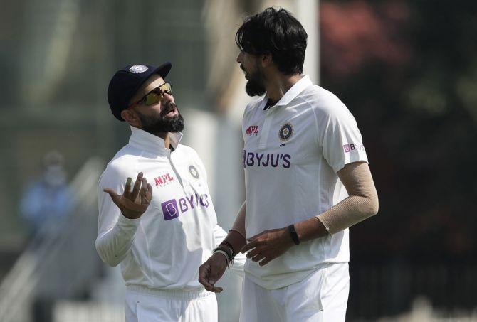 India captain Virat Kohli speaks to pace bowler Ishant Sharma