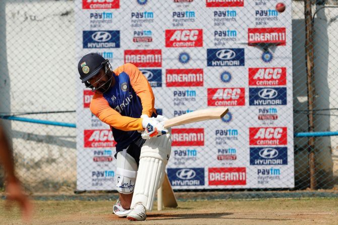 Rohit Sharma practices the sweep shot at a practice session on Friday
