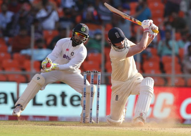India wicketkeeper Rishabh Pant takes the catch to dismiss Dom Sibley off the bowling of Axar Patel