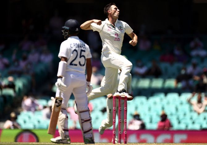 Australia pacer Pat Cummins celebrates after dismissing Cheteshwar Pujara on Day 3 of the third Test against India, at the Sydney Cricket Ground, on Saturday.