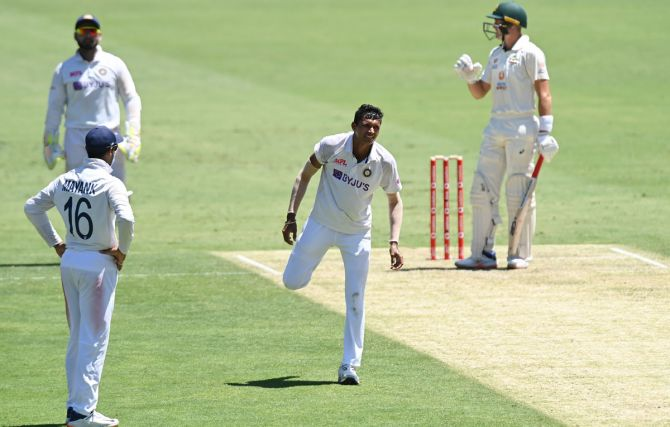 Navdeep Saini suffered a groin strain in Australia's first innings in the Brisbane Test and could bowl only 7.5 overs, increasing concerns for an already injury-hit India, who were forced to go into the game with a bowling attack which had the combined experience of four games