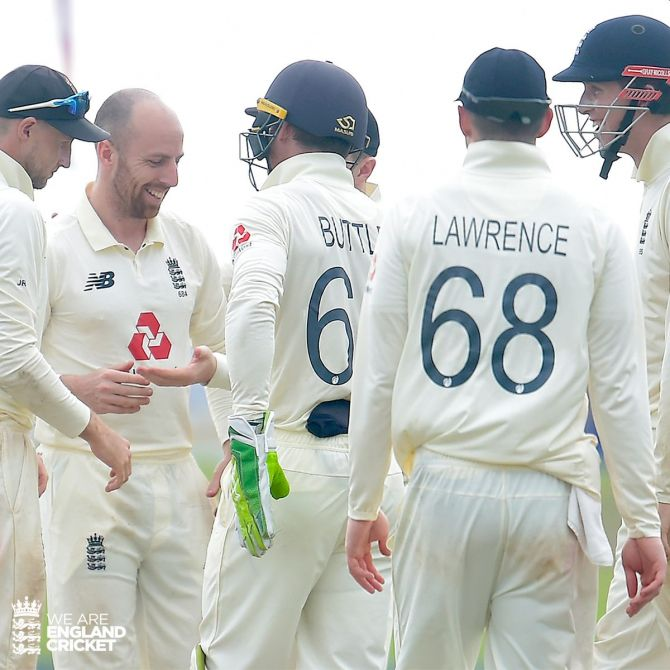 England's Jack Leash celebrates with teammates on claiming five wickets in the opening Test in Galle on Sunday