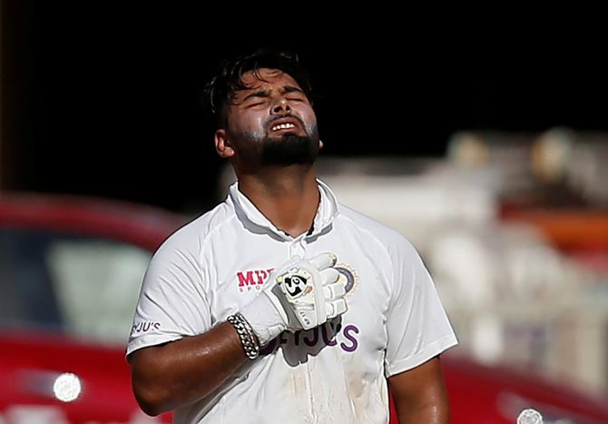 India's Rishabh Pant reacts after completing his century on Friday, Day 2 of the fourth Test against England