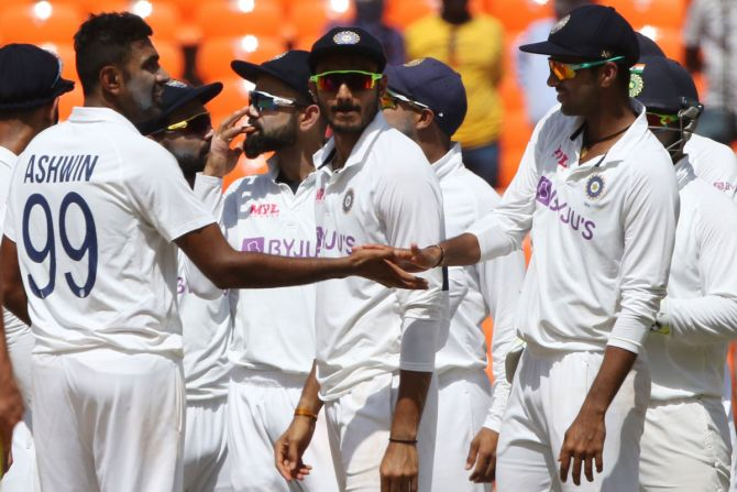 India players celebrate a wicket. Talking cricket has helped players understand each other better.