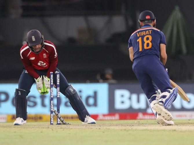 Virat Kohli is stumped by England wicketkeeper Jos Buttler