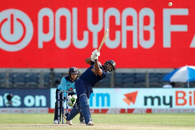 Rishabh Pant hits a six.