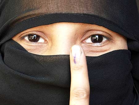 A Muslim voter in Mathura, Uttar Pradesh, shows off her voting mark, May 7