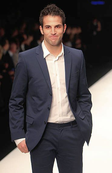 Spanish footballer, Cesc Fabregas also walked the runway at the same show, striking a relaxed pose in trousers and a deep blue jacket