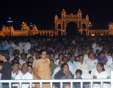 People watching a cultural programme at the palace premises.