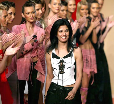 Ritu Beri is applauded at the end of her show for Scherrer's spring/summer 2003 ready-to-wear collection in Paris, 2002