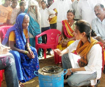Juneja with villagers at a demonstration