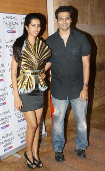 Swapnil Shinde poses alongside a model wearing a design from his latest collection