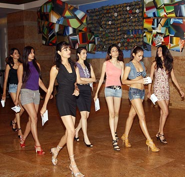 Would-be models strut their stuff in the hotel lobby