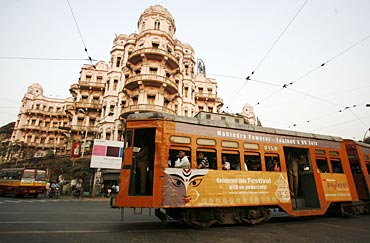 A tram passes beside a heritage building in the eastern Indian city of Kolkata