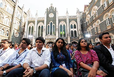 Students listen to US President Barack Obama during a town hall meeting at St. Xavier's College in Mumbai