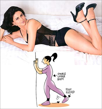 Standing rear leg raises for Gul Panag's voluptuous curve