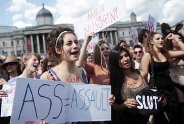 SlutWalk participants cheer a speaker in Trafalgar Square, central London, June 11, 2011