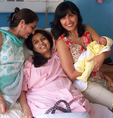 Harnoor (centre) with her mother (L), sister and her newborn baby girl