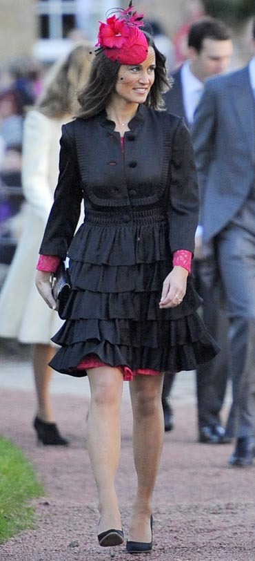 Pippa Middleton arrives for the wedding of the Duke and Duchess of Northumberland's daughter Katie Percy to City financier Patrick Valentine at St Michael's Church in Alnwick, Northern England on February 26, 2011