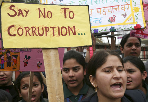 School students shout slogans during a protest against corruption