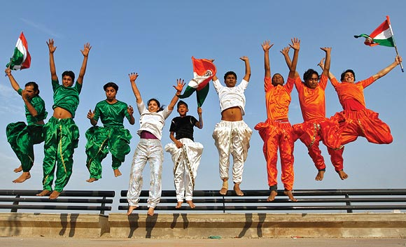 College students dressed in the colours of the national flag rehearse for the Republic Day parade in Ahmedabad, January 24, 2012. Photograph: Amit Dave/Reuters