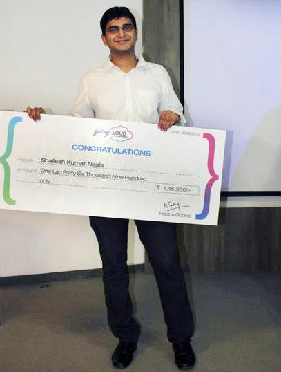 Shailesh Nirala with the cheque he won as part of Godrej LOUD contest