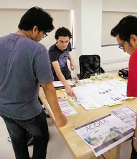 Game design students at DSK Supinfogame discussing playtest of play prototypes