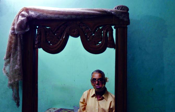 Navin Khanna, 68, an oral cancer survivor, who said he had consumed gutka for almost six years until doctors detected cancer in his mouth, at his home in New Delhi, August 17, 2012. Ten Indian states have banned gutka, a form of chewing tobacco. Dr Manu Prakash's OScan may enable early diagnosis of oral caners, with no dentist visits required.