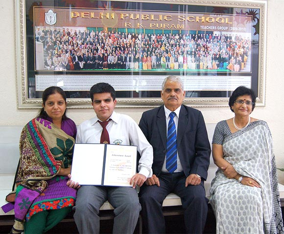 Kartik (second from left) displays the certificate announcing his first place victory at the Global IT Challenge for Youth with Disabilities in South Korea in November 2012; seated to his right is mother Indu Sawhney and to his left, Delhi Public School, RK Puram principal Dr D R Saini and vice principal Shobha Mehta